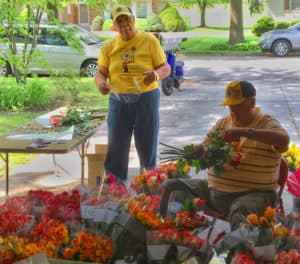 guys cutting and bagging flowers
